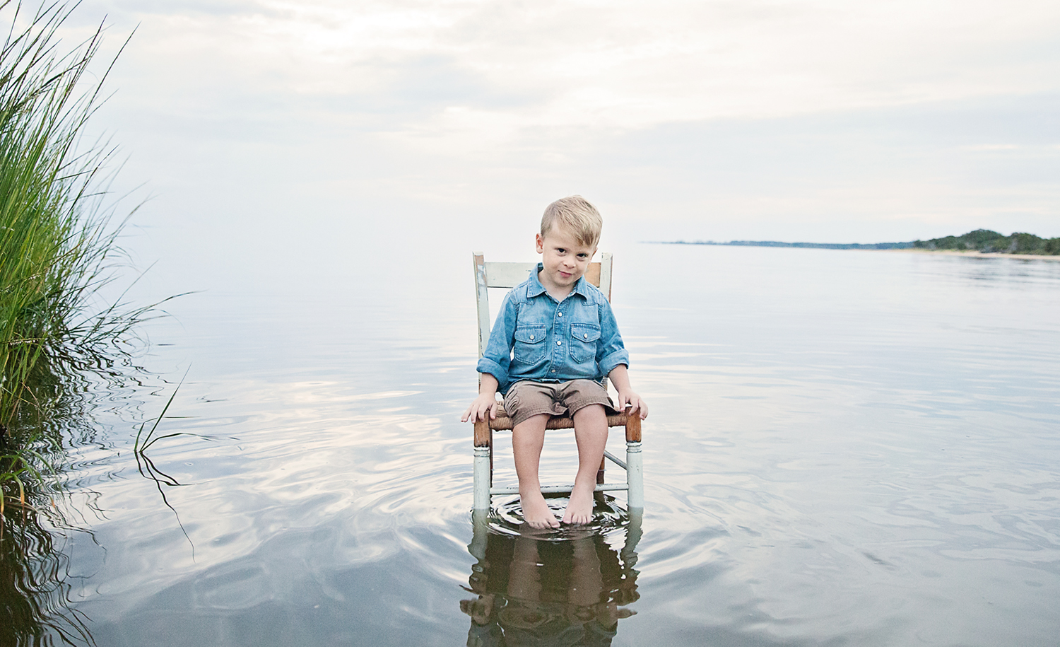 Young boy in a chair in the Pamlico Sound