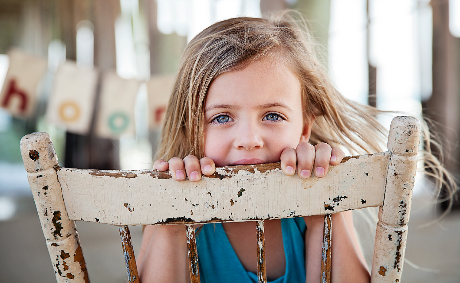 Little girl with blue eyes under Kitty Hawk pier in North Carolina