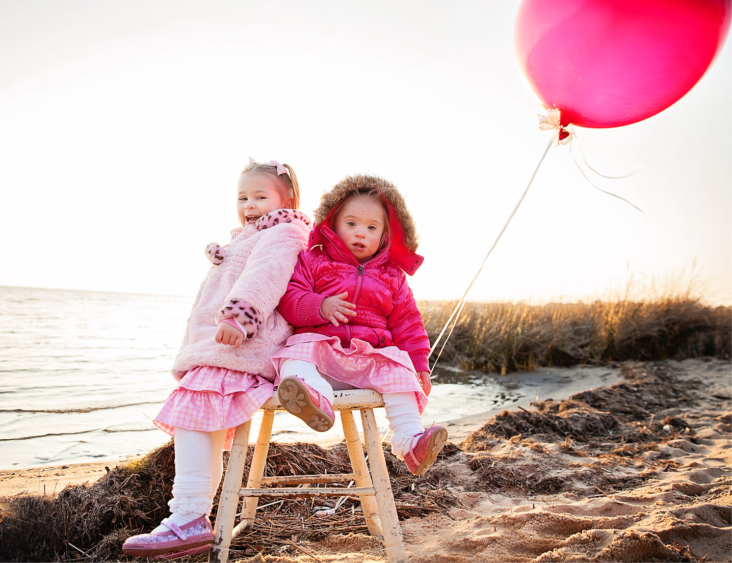 Sisters with pink balloon at Jockey's Ridge State park