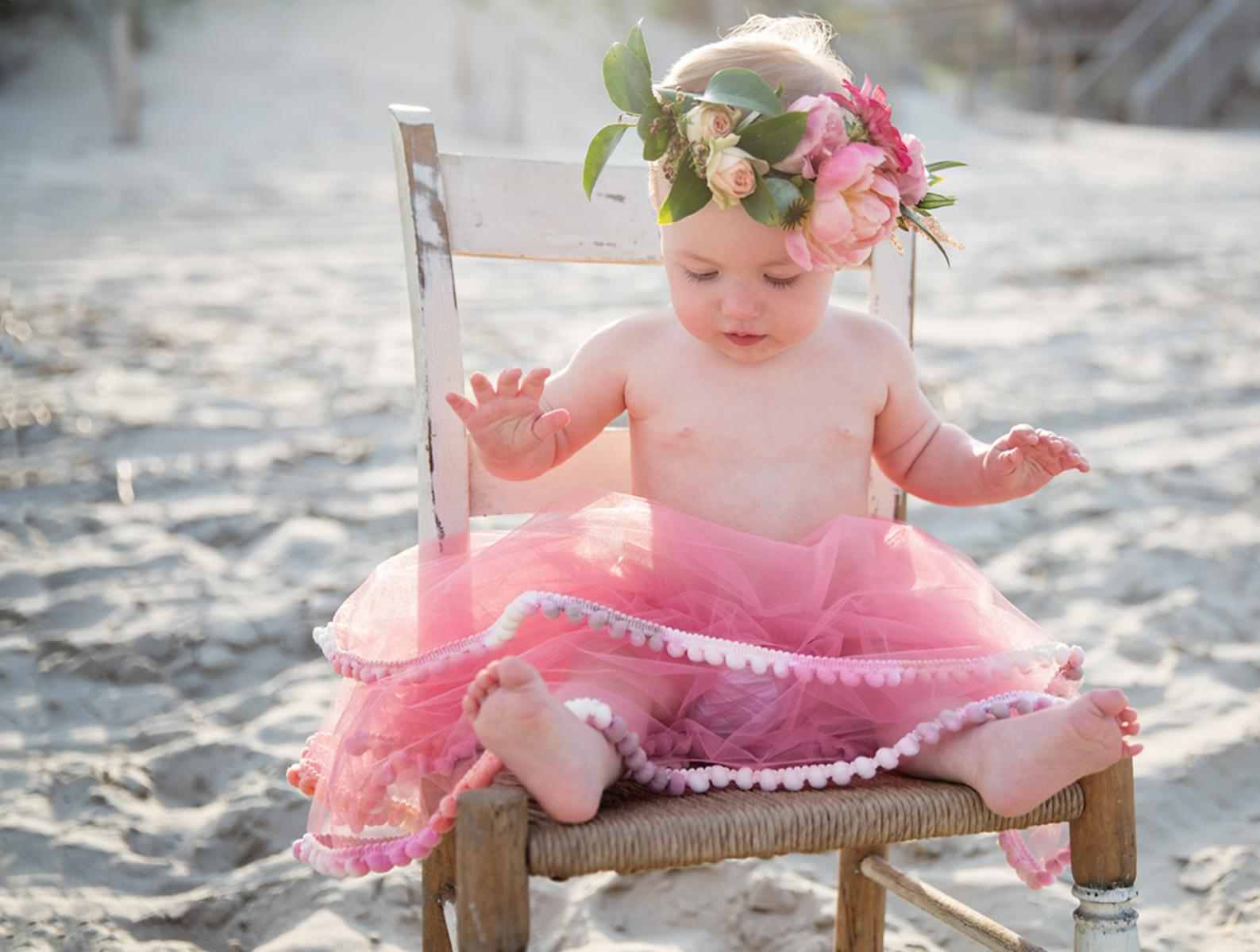 One year old birthday photos of girl in tutu and flower crown