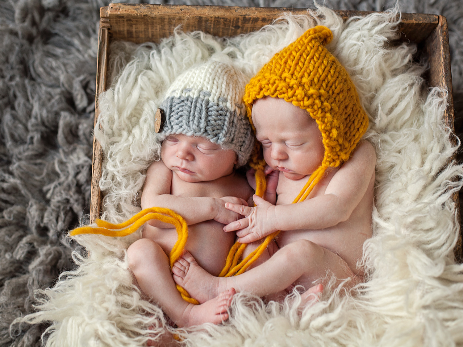 newborn twin boys cuddle in a box in Outer Banks NC