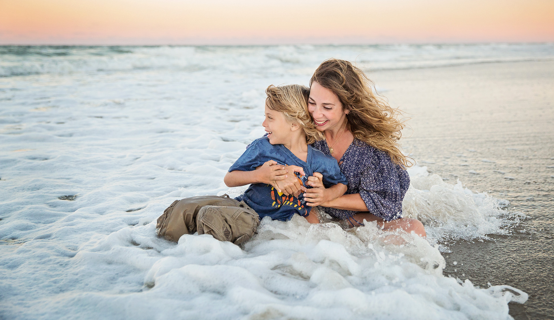 Mom and son playing in the ocean - lifestyle photography OBX