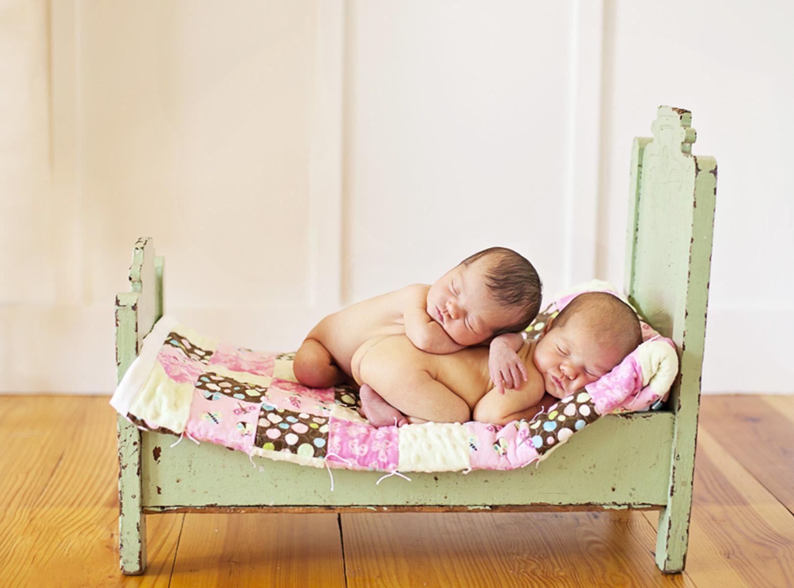 Outer Banks newborn photographer twins in dollbed