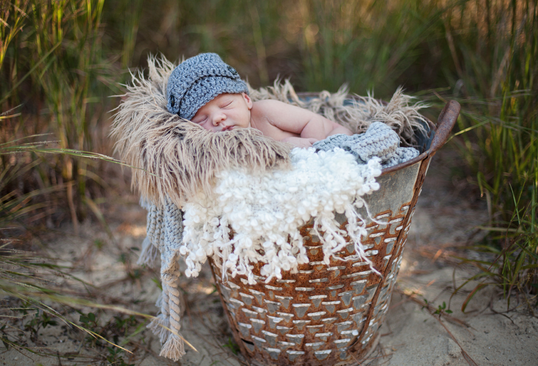 Outer Banks NC newborn photo of baby boy in metal bucket
