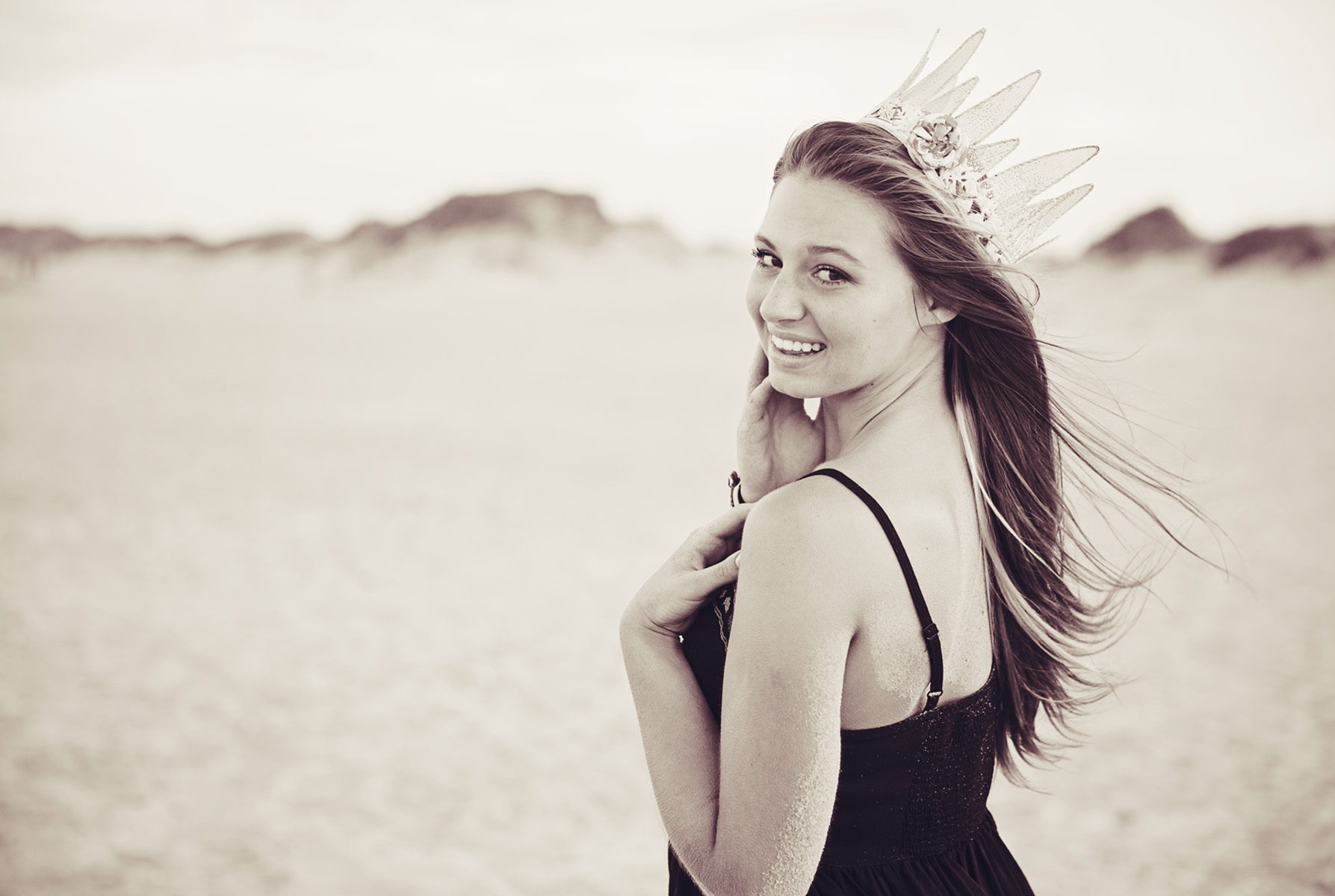Senior girl with crown at the beach