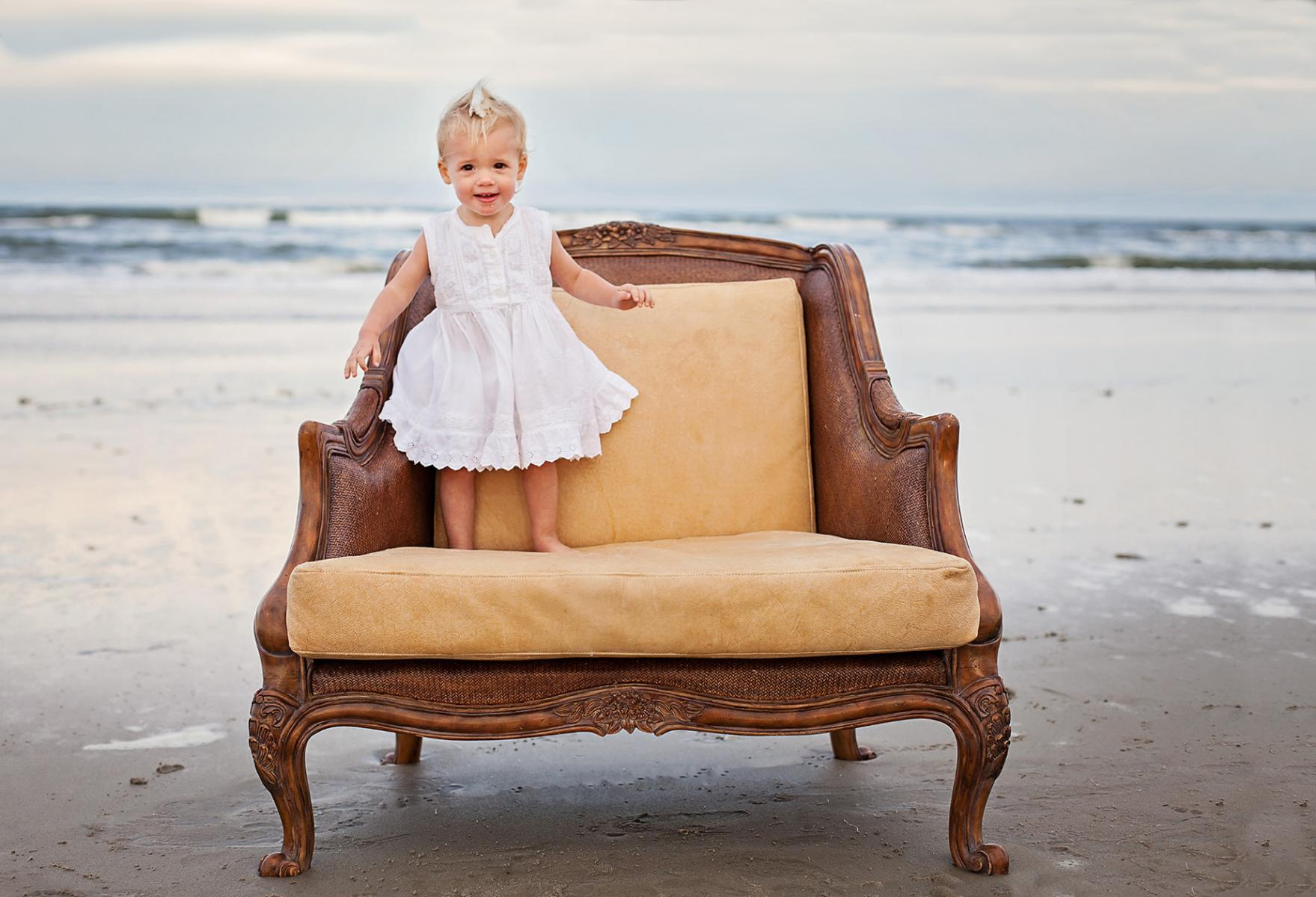 Sweet little girl photograph on chair at the beach Corolla NC